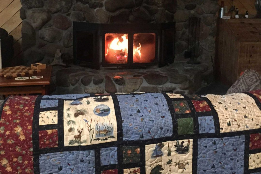 Fireplace and handmade quilt